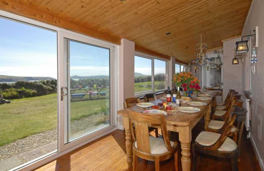 St Justinians holiday cottage - colonial veranda with views of Ramsey Island-dining area