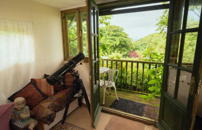 Sit in the summerhouse and enjoy breathtaking views over the orchards to the sand dunes beyond