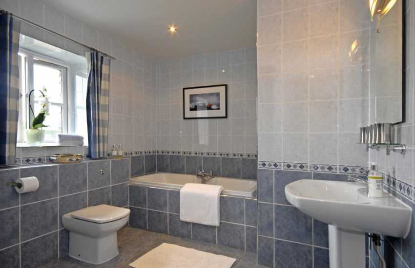Solva holiday home - ground floor family bathroom with wet room area