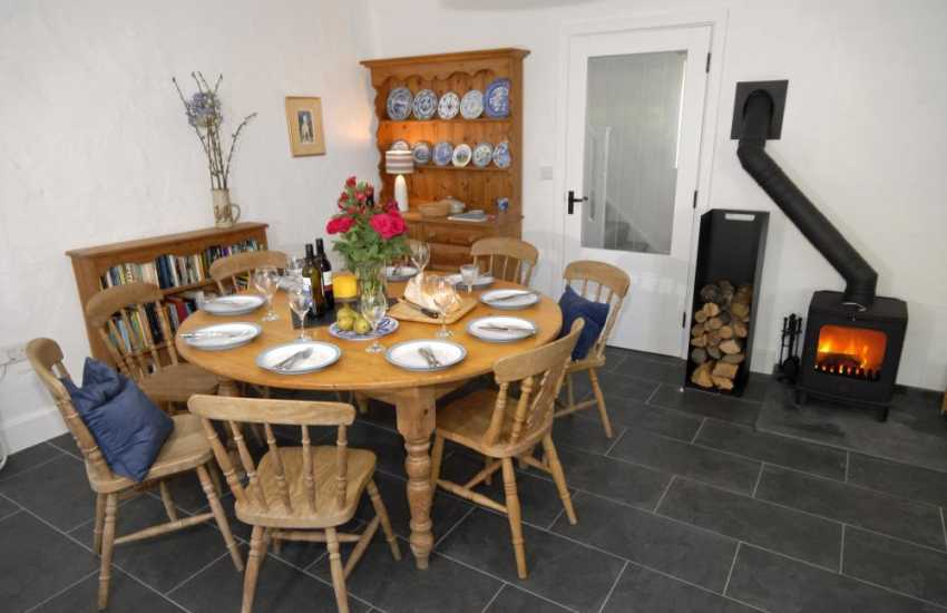 Self-catering cottage Newport - cosy dining area with wood burner