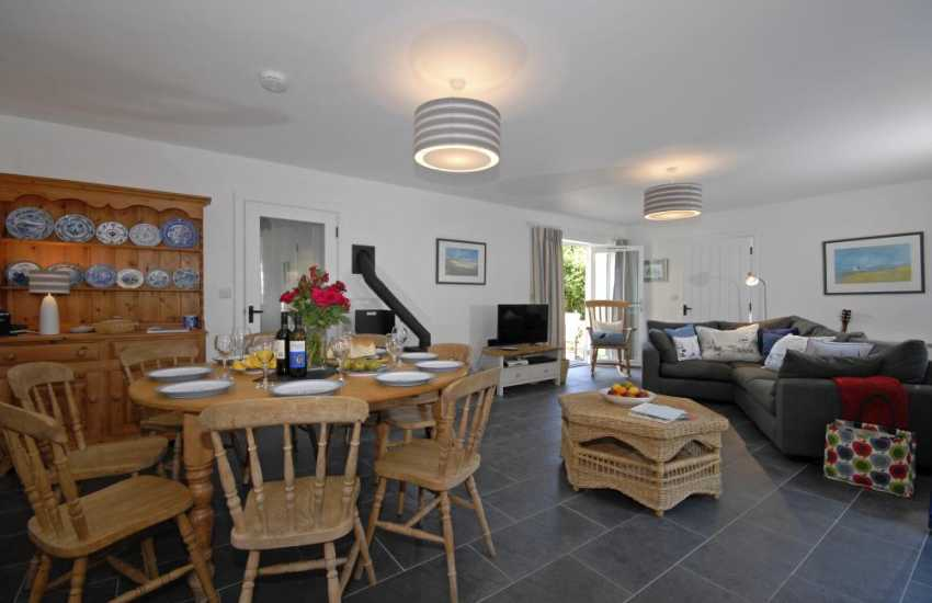 Self-catering cottage Cwm yr Eglwys, Newport - open plan dining/sitting room with log burning stove