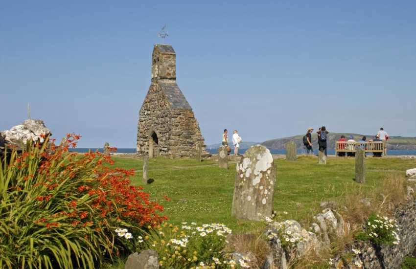 The remains of 12th century St Brynach church destroyed during a storm, overlooks the beach at Cwm Yr Eglwys