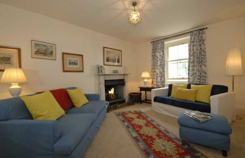Manorbier family holiday home - cosy sitting room with open fire