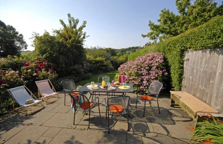 Manorbier holiday cottage enclosed rear patio and cottage gardens - pets welcome