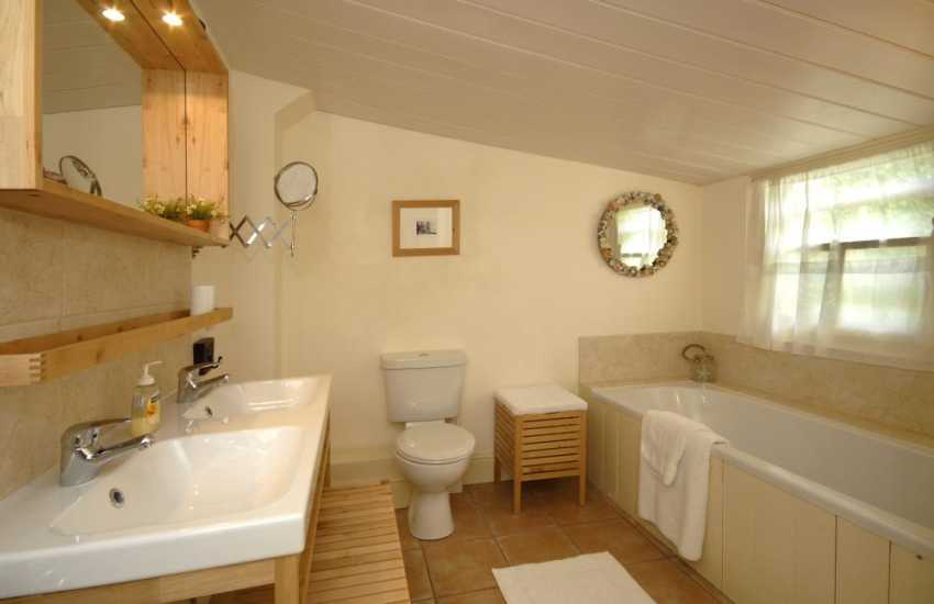 Manorbier holiday home - family bathroom with double wash basin