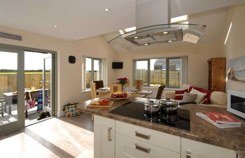 Self catering Solva - kitchen/dining area with bi-fold doors to the patio