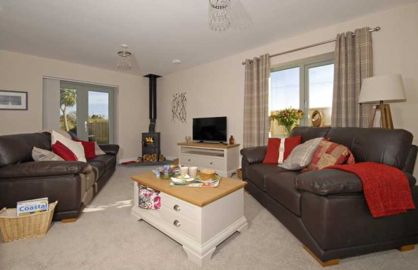 Solva holiday home - comfortable sitting room with T.V and log burner