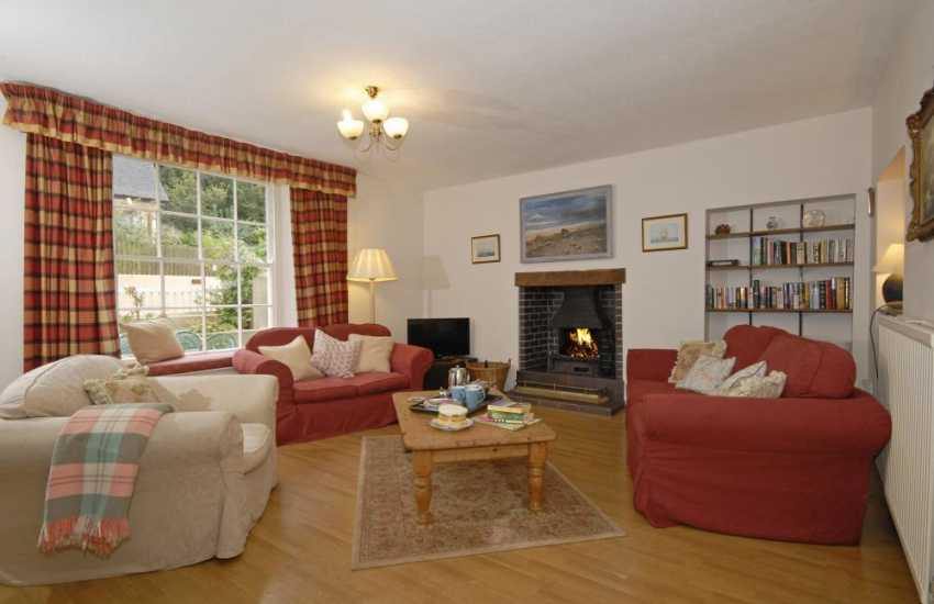 Dale, Pembrokeshire, family holiday home - comfortable sitting room with open fireplace