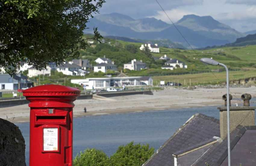 Use Criccieth's picturesque postbox to send your postcards