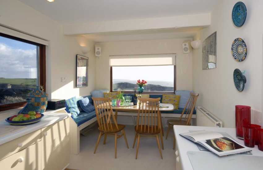 North Pembrokeshire self catering modern holiday home - dining area overlooking St Brides Bay and the coast