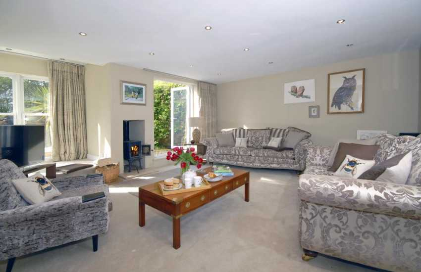 Little Haven holiday home - cosy sitting room with log burning stove
