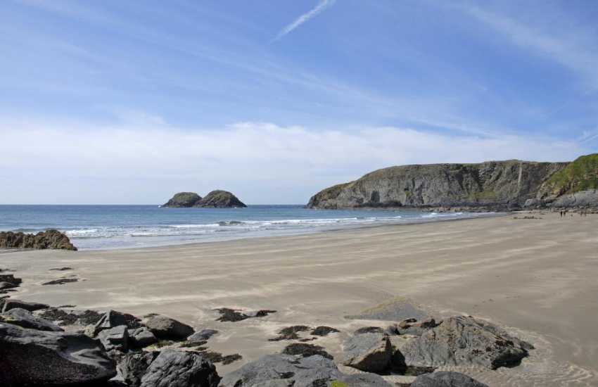 Traeth Llyfyn Beach - a wide expanse of sand great for family beach days, picnics and games