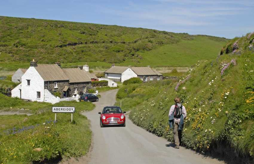 Abereiddy has pretty colour washed former miners cottages and a black sandy beach where dogs are welcome all year round