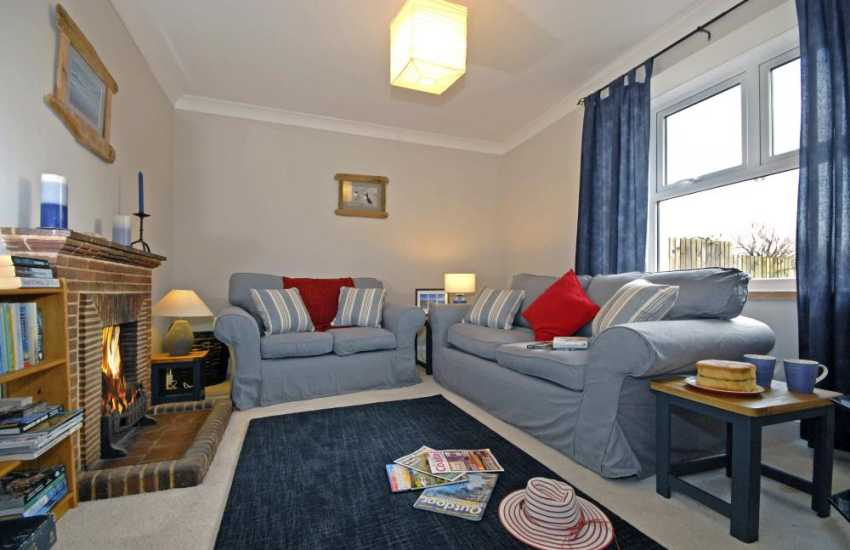 Marloes holiday cottage - living room with open fire