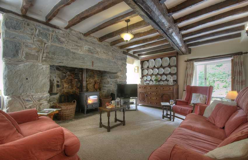Lounge with wood-burner in rural Welsh holiday cottage near Dolgellau