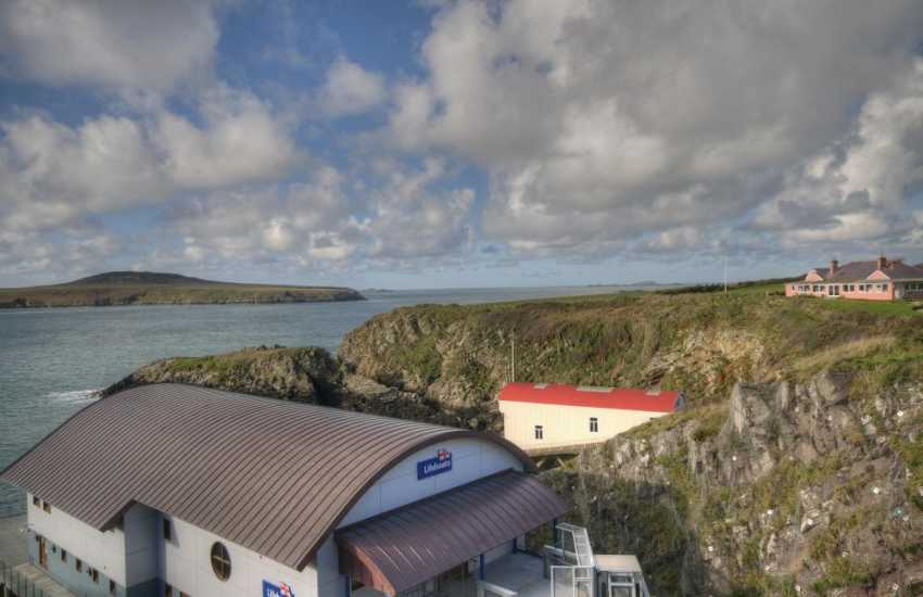 The new Lifeboat station at St Justinians with the old one - Island cruises start from the slipway here