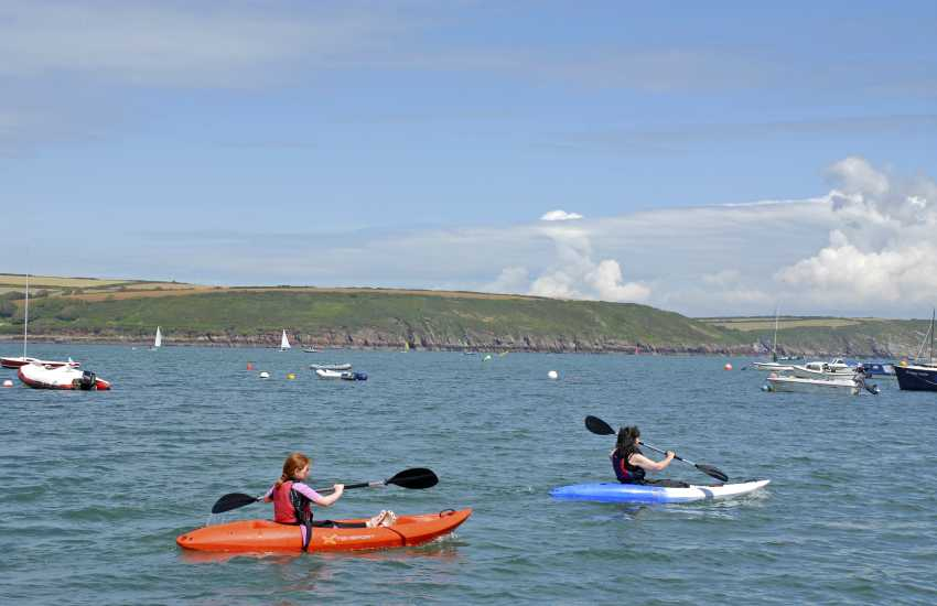 Try surfing, sailing, coasteering, windsurfing or kayaking for an hour or more