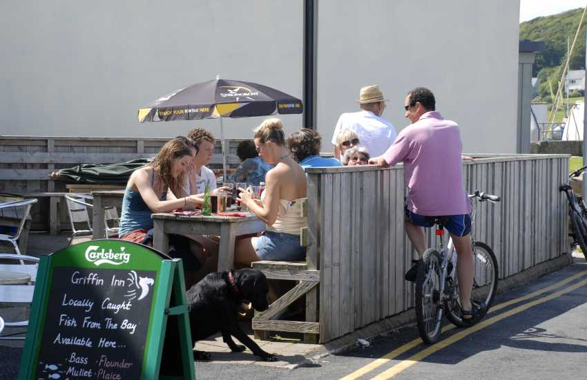 Alfresco dining in Dale - The Griffin Inn which overlooks the bay or try The Boat House shop and cafe for delicious homemade snacks
