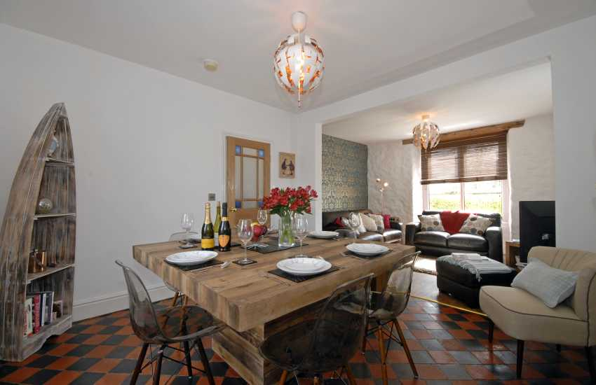 Open plan dining/living room with electric wood effect log burner