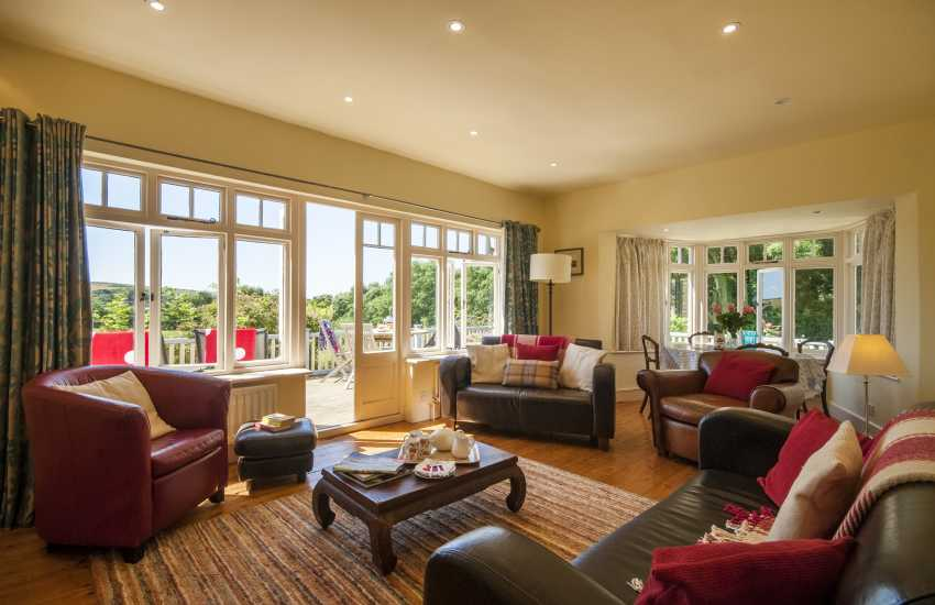 Manorbier coastal holiday home - cosy sitting room with open fire