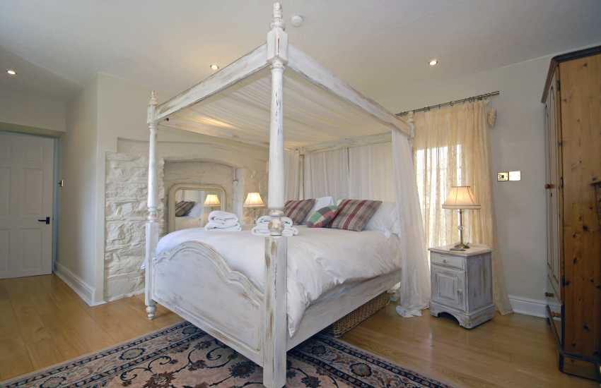 Master four poster king size bedroom