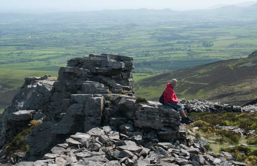 Tre'r Ceiri hillfort stands 450 metres above sea on an exposed peak of Yr Eifl on the Llyn Peninsula. It is one of the best preserved and most densely occupied hill-forts in Britain