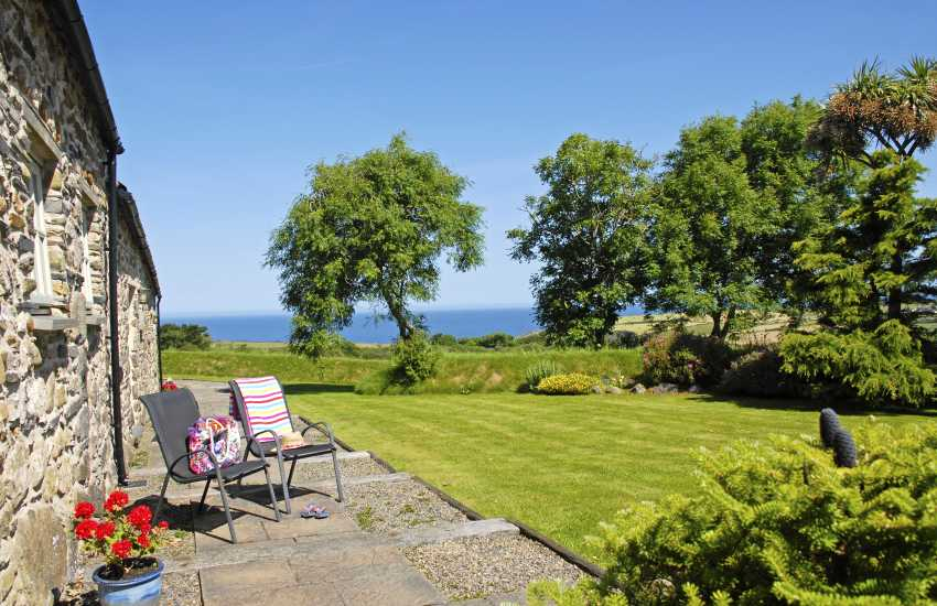 Hafan Bach patio with garden and sea views