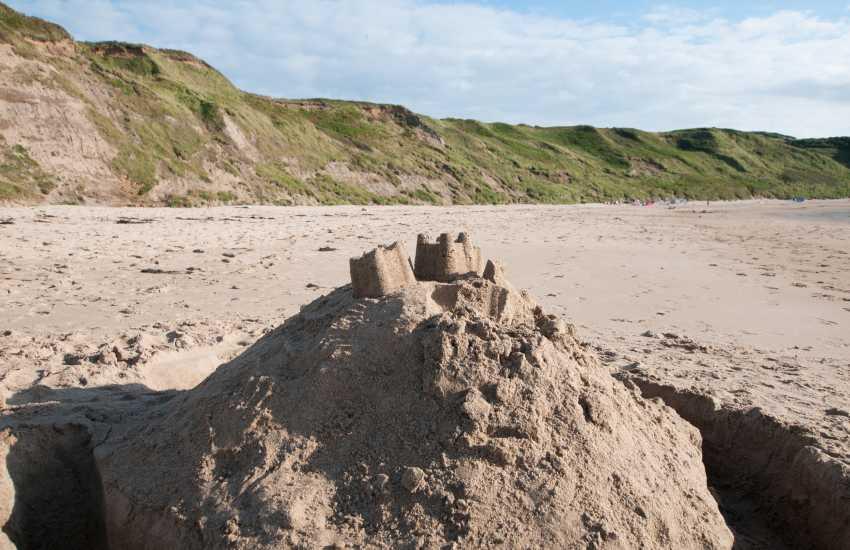 Sand castles at Porth Oer (Whistling Sands)