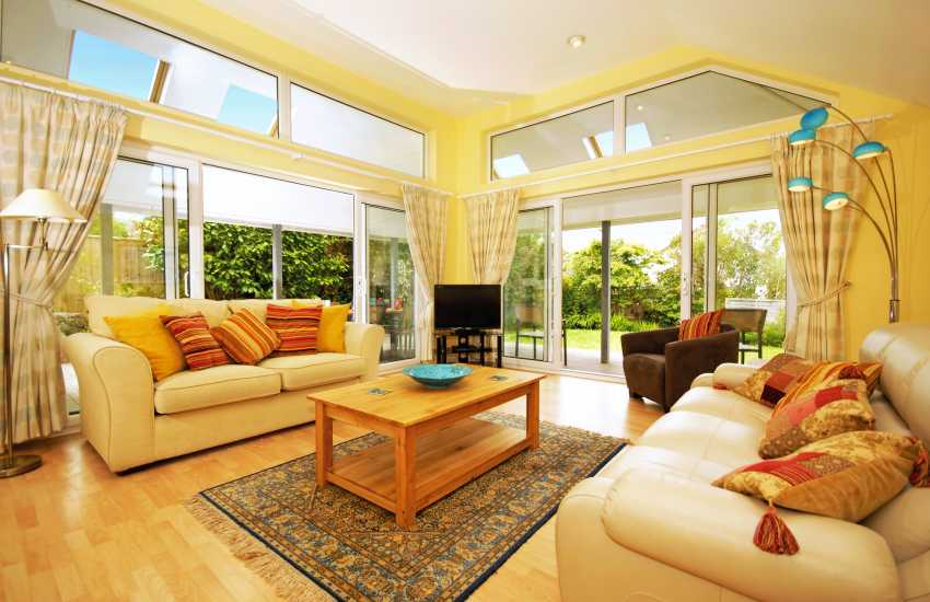 Luxury modern house in Newport - sitting room with double aspect patio doors to garden  and deck