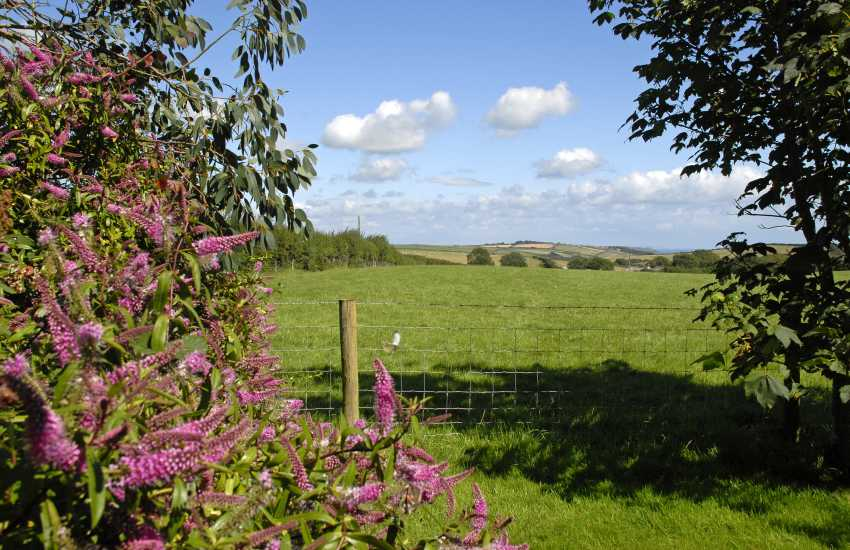 Enjoy panoramic views over rolling fields to the coast at Manorbier