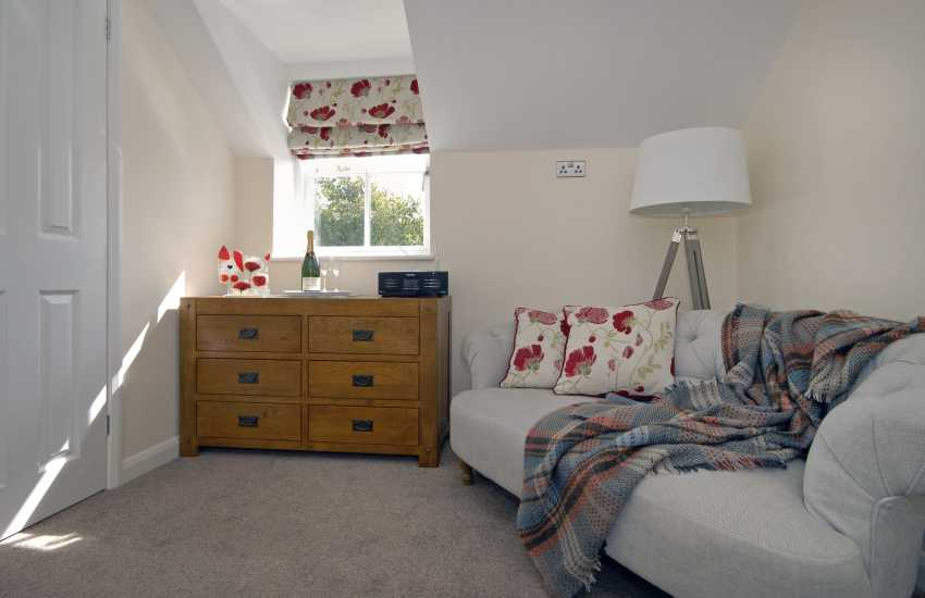 Master bedroom with comfy sofa