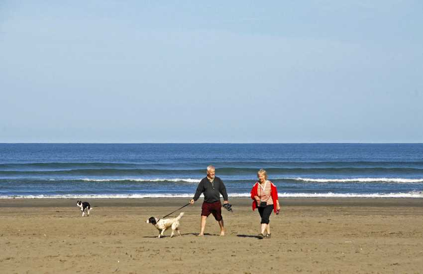 A brisk walk on Poppit sands - most Quality Cottages welcome dogs