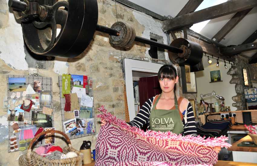 Do visit Solva Woollen Mill - it has a newly restored waterwheel, looms weaving beautiful carpeting and rugs as well as a mill shop and tea rooms