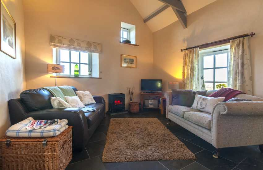 Porthgain holiday cottage living room with feature electric stove