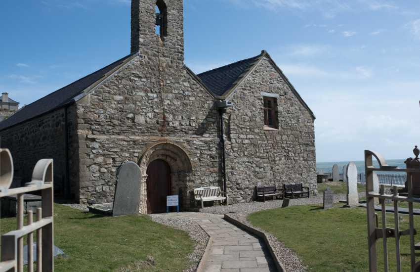 Iconic St Hywyn's church beside the beach Aberdaron
