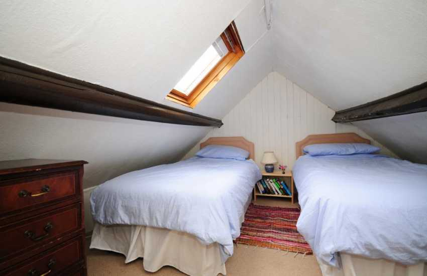 Twin bedroom on 2nd floor with restricted head height