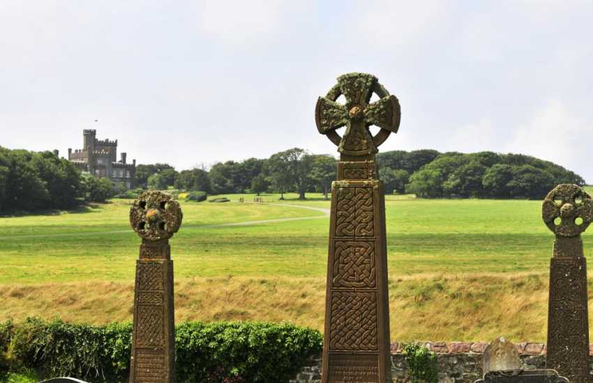 Welsh Celtic crosses stand tall in the grounds of St Brides Church on the Pembrokeshire Coast Path