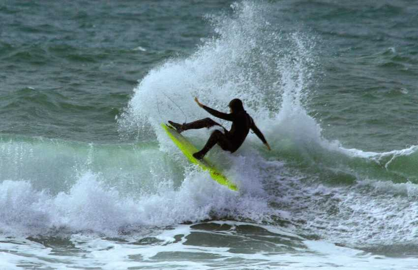 Newgale's Atlantic rollers offer thrilling surfing opportunities. Newsurf located near the beach has a full hire service and surfing tuition