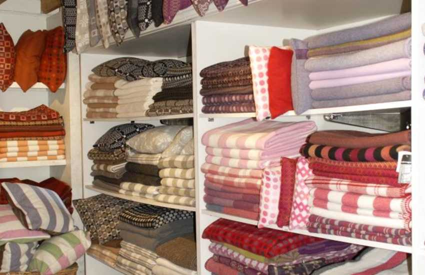Do visit Melin Tregwynt - an 18th century working mill famous for its exclusive Welsh design woollen blankets, throws, cushions and clothing with other stockists including John Lewis & Harrods