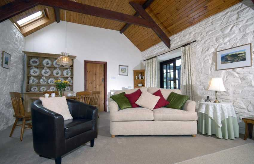 Wales Pembrokeshire holiday home - open plan living space and wood burning stove