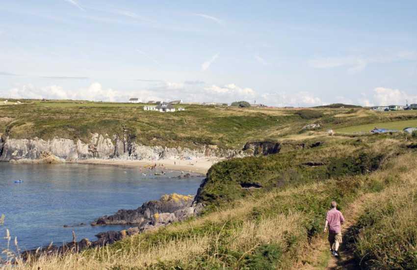 Walking on the Pembrokeshire Coast Path towards Porthselau (Porth Seli) Beach near St Justinians
