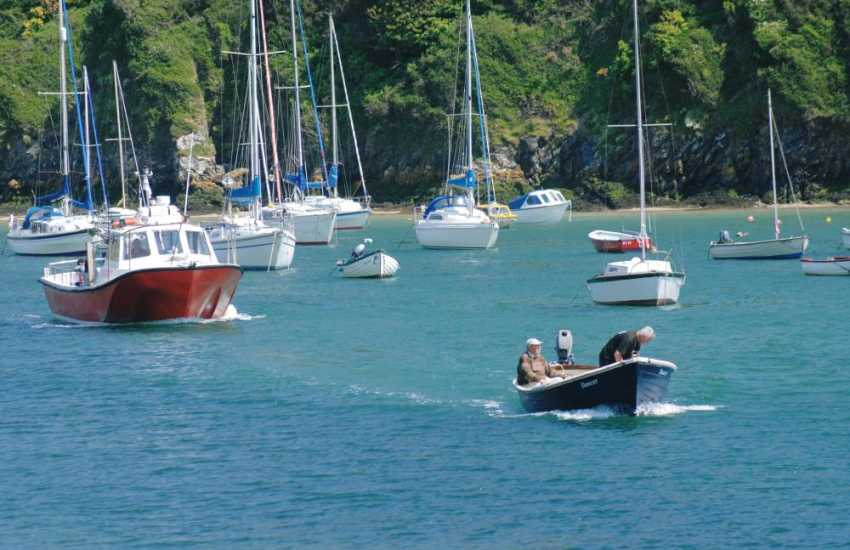Sailing boats on the waters of the Solva River - Water-sports and boat trips can be booked down by the harbour