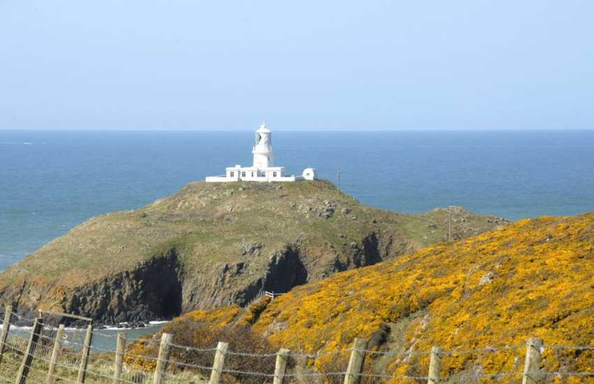 Strumble Head Lighthouse on the coast - a favourite place to spot dolphins, porpoise and migrating sea birds