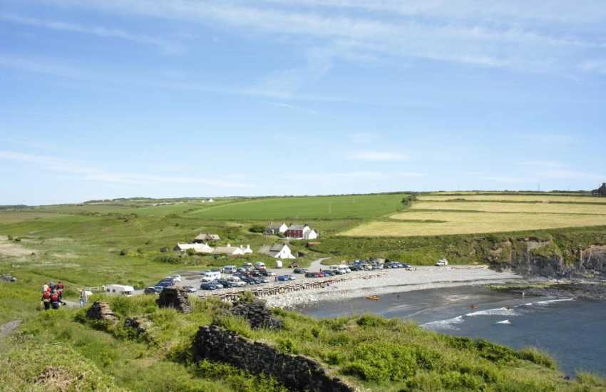 Nearby Abbereiddy is a 'blue' sand and shingle beach popular with families and great for fossil hunting