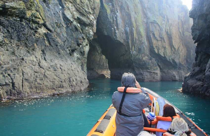 Enjoy magnificent caves, coastline and marine life on a boat trip over to Ramsey Island