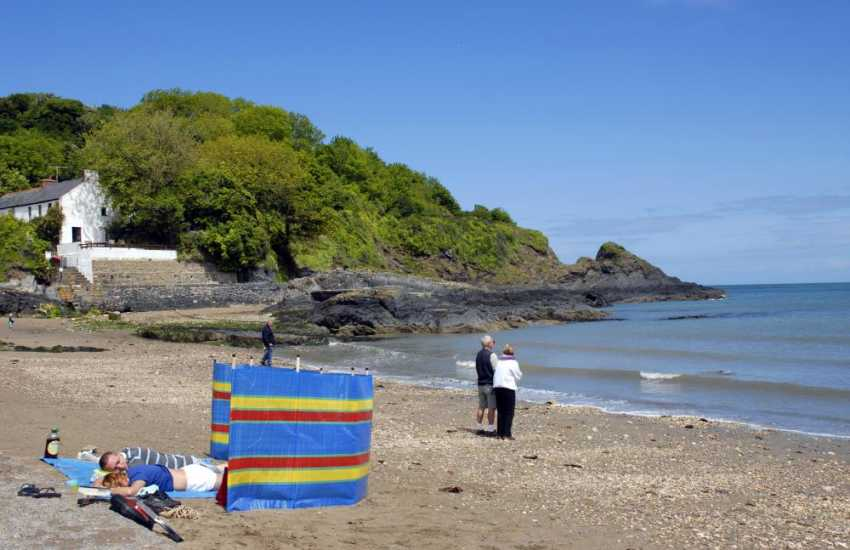 Cwm yr Eglwys is a tiny sheltered cove on the Pembrokeshire Coast Path -  popular with families