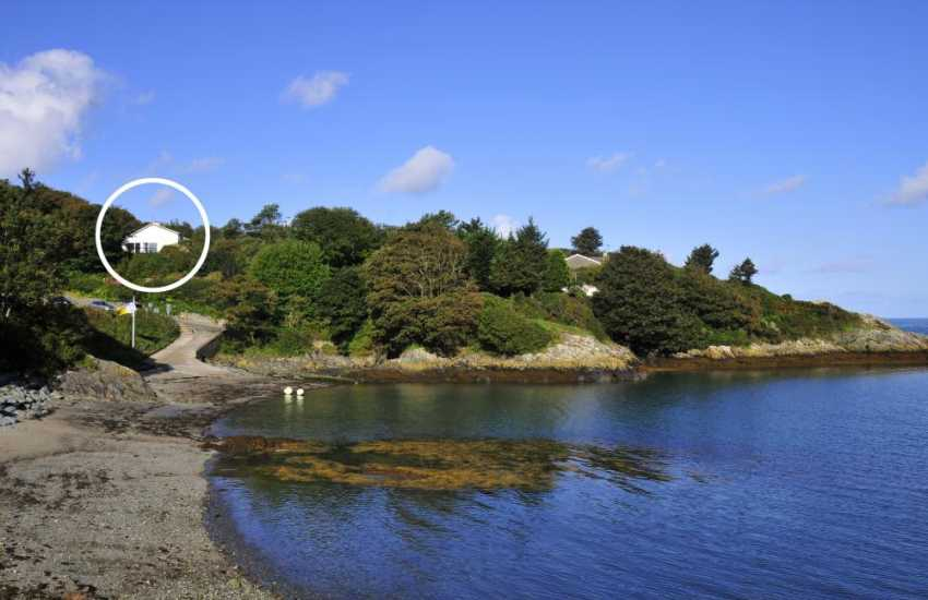 Large holiday cottage in extensive gardens overlooking Llaneilian Bay