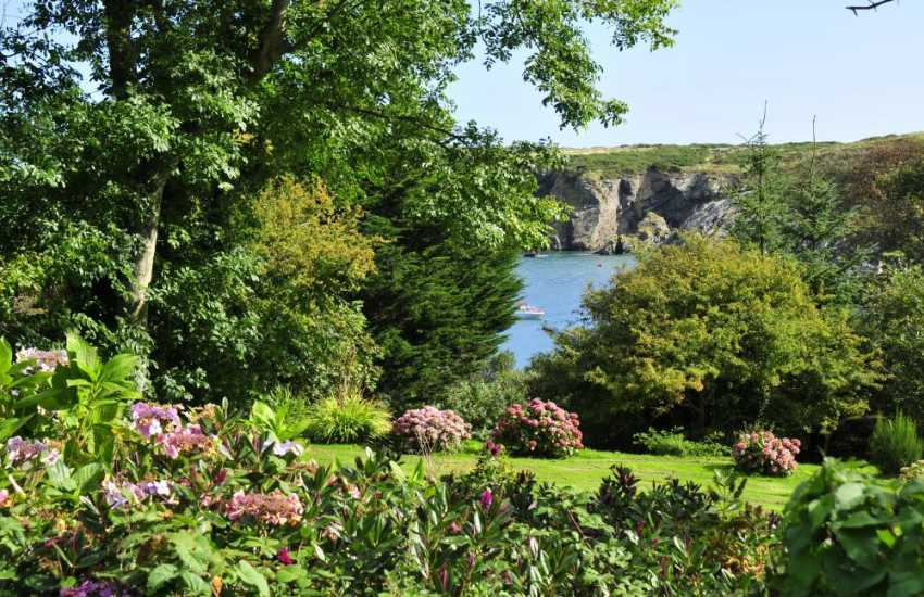 Views over the Bay from extensive gardens at Llaneilian holiday cottage