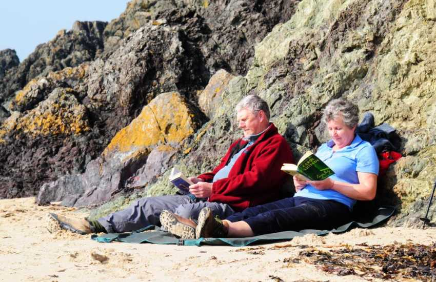 Relaxing on the beach with a book in March