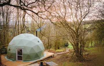 The glamping geodome for 2 people and 3 dogs looks across the Shropshire countryside